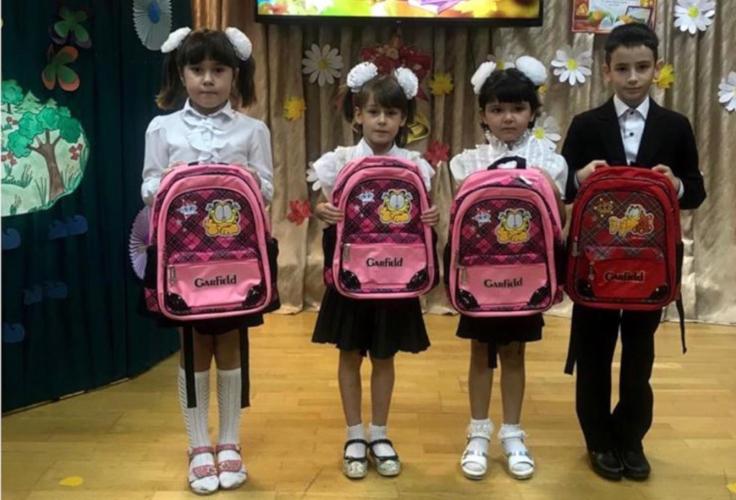 Школьные портфели в подарок детям